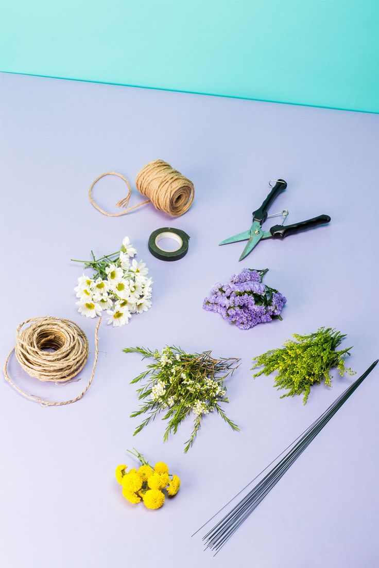 """need: 2-3 types of flowers, trimmed to 3"""" pieces (Try micro daisies, yellow pom poms, purple statice for our crown) & 1-2 types of filler (aster flower or baby's breath) trim to 3"""" pieces. A pliable twine-covered wire (Oasis Wire/Floral wire/Floral tape/Plain twine or ribbon/Garden shears or sharp scissors)"""