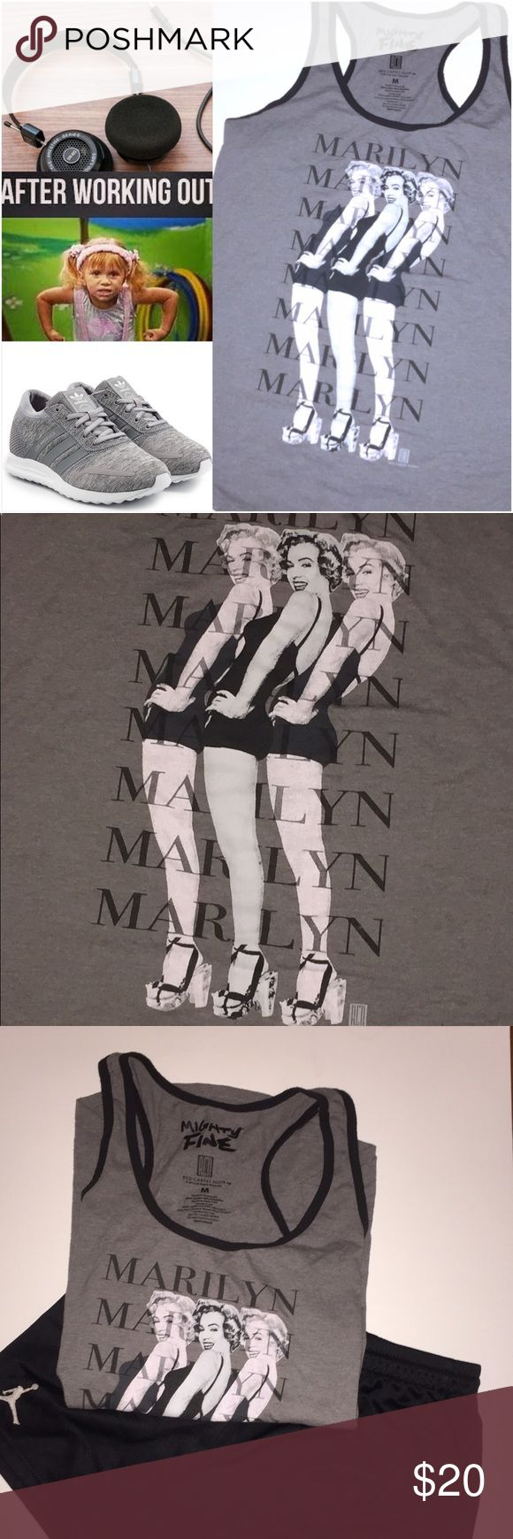 Marilyn Monroe Muscle Tank Gray Marilyn Monroe Sleeveless muscle tank. Gray with black trim and black and white print. Fashionable and will look great with any outfit. Tackle your New Year's Resolutions while staying fashionable! New condition. Super cute and trendy. ✨✨✨ Bundle and save! ✨✨✨ Tops Muscle Tees