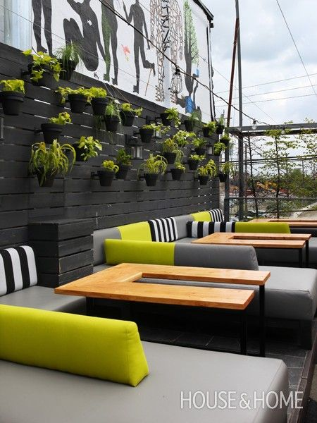 Casual Rooftop Terrace | Bright yellow pops against sedate black, white and grey cushions.