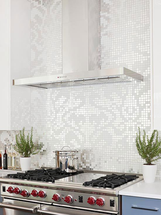 Iridescent Tile BacksplashA wall covered with white and white-gold mosaic tiles makes a striking style statement in this kitchen. Set opposite the room's windows, the tile's shimmering pattern varies in intensity as the lighting changes throughout the day. A clean-lined range hood allows the backsplash to take center stage.