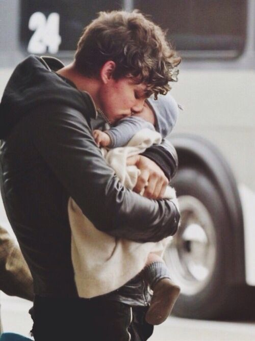 He stood against a pillar opposite the bus. In his strong arms was his baby brother. He was fighting not to cry. Leaning down to plant a kiss on his cheeks, he whispered to the baby. 'Don't forget me,' he choked out. 'Because I will never forget you, baby boy.' As he lifted his head, a tear landed on the baby's cheek. Hey, he thought, that tear will water the seed of a kiss I just planted. - Hetty