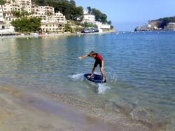 Port of Soller late September. My son Skimboarding