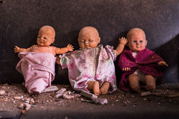 Three dirty childrens dolls were left on one of the couchs in the property