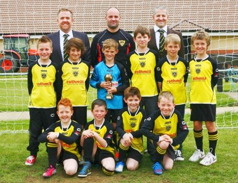 If you are going to do a team photo shoot, then make sure you do it like this Junior Side in Leicestershire who was proud to show off their new Stanno Porto Kit. A special mention to the coaches who 'suited up' for the occassion.  For more information on the Stanno Porto Jersey, please follow the link below:  http://www.mdhteamwear.co.uk/home/shirts/stanno-shirts/porto-shirt