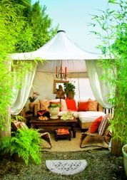 Tent a corner of the garden. A lofty cabana offers a glamorous hideaway just steps from the back door.  Similar to shown: 10-by-10-foot Mandalay Gazebo Canopy, about $220; Ace Canopy