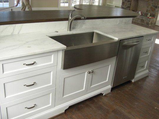 15 Farmhouse Sinks for Every Kitchen Imaginable - white cabs, stainless D/W and apron-front sink, marble, dark wood