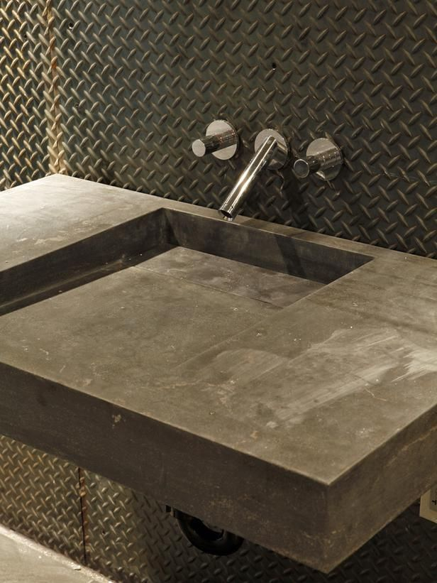 DIamond plate metal flooring... used as a bathroom wall treatment... with cement sink... THIS IS COOL!