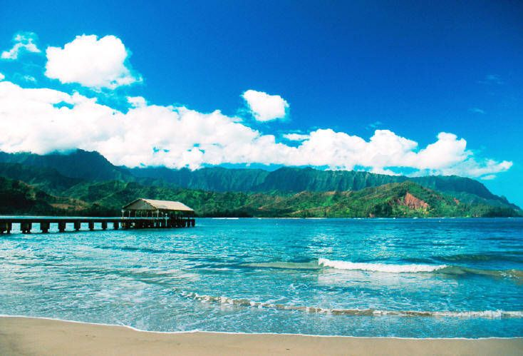 My favorite beach for lounging, Hanalei Bay. Very placid in the summer, quite a few different surf breaks in the summer. The end of the beach near the pier is busy, the opposite end is empty and very private.