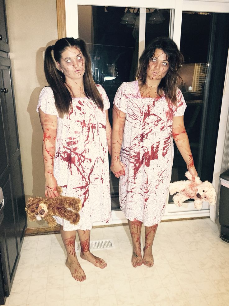 We were the Grady twin from the movie The Shinning. We didn't have those exact dresses they wore in the movie so we decided night gowns would be a good idea! Makeup was also done by me. :)