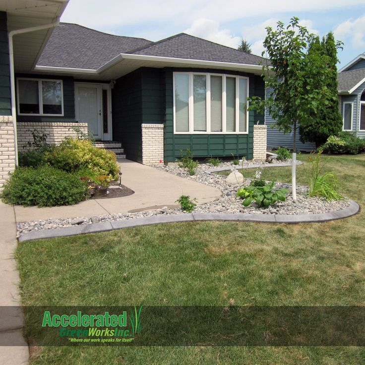 Sidewalk entry recreated with a new maple tree and for Grey rocks for landscaping