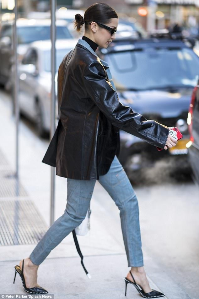 Leggy look: Bella added a wet-look black jacket and pointed toe black heels embellished wi... #bellahadid