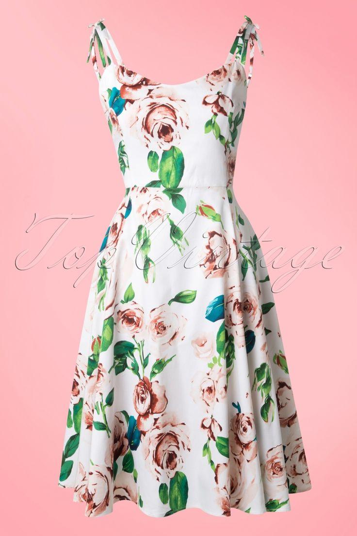 Nieuwe lente/zomer collectie ~ Deze50s Janie Floral Swing Dress in White van Collectif is een heerlijke romantische swing jurk!Iedere vrouw houdt van de kleur roze, rozen en jurkjes. Al dat goeds is verwerkt in deze beauty dus we kunnen niet anders dan van deze jurk houden! Het lijfje heeft een mooie sweetheart halslijn en dubbele verstelbare bandjes die bovenop de schouder een schattig vast strikje hebben. Vanaf de taille uitlopend in een volle swing rok die voor een extra feestelijk ...