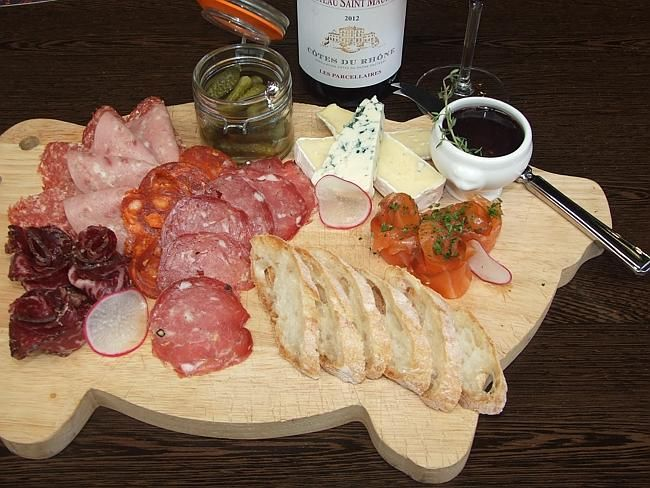 A platter big enough for two with several types of French cold cured meats, French cheese