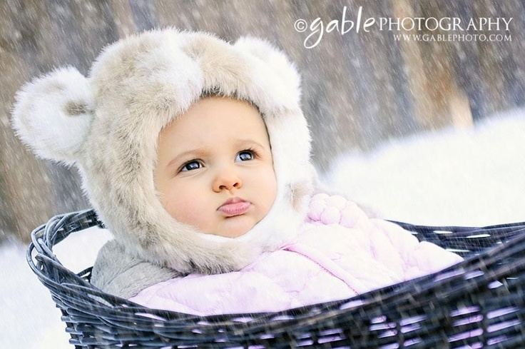 Baby in snow -photography. Actually simulated snow post processing.