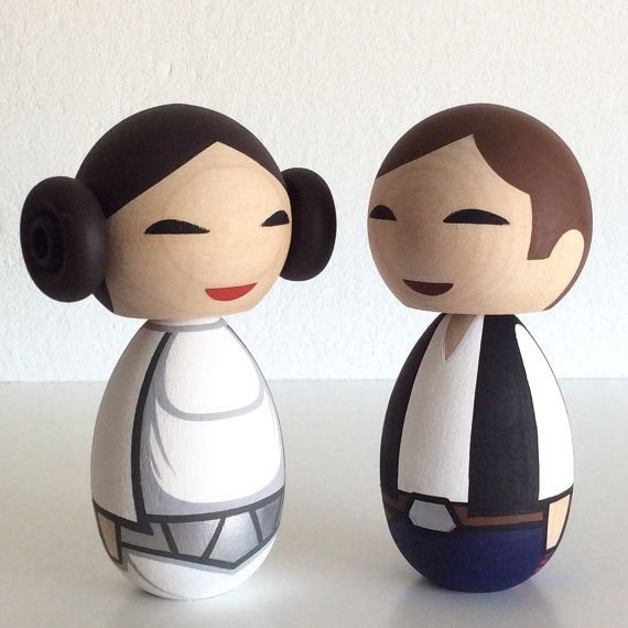 Really awesome Etsy listing at https://www.etsy.com/pt/listing/76711340/kokeshi-dolls-han-and-leia-inspired