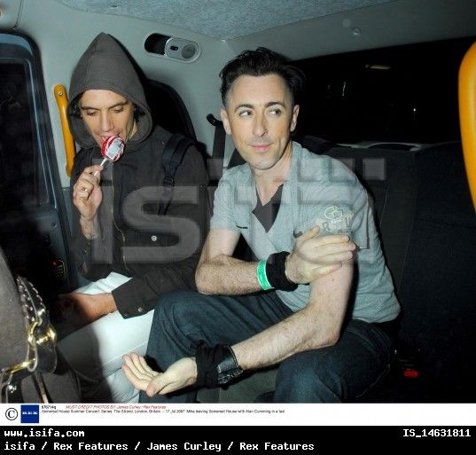 Alan Cumming with Mika sucking too hard on his lollipop xD - seen leaving his concert at London's Somerset House 2007