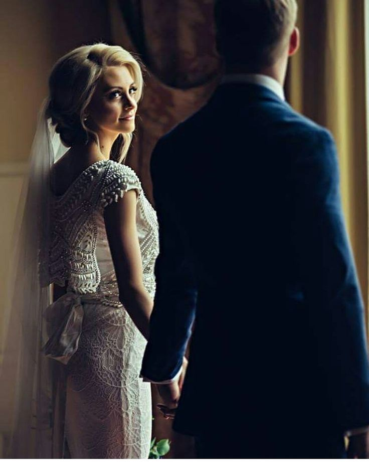 modest wedding dress with draped sleeves and a fitted lace skirt from alta moda (modest bridal gown)