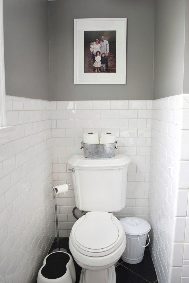 love this setup for the toilet in a kids' bathroom. toilet paper, extra wipes, a trashcan and a step stool #BathroomToilets