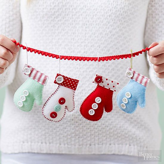 """Add this adorable string of mittens to any window that needs some Christmas spirit. Search """"mitten silhouette"""" online and choose a pattern to print. Cut out pattern and trace onto felt, tracing two mitten outlines for every ornament you want to make. Cut out felt, and using contrasting embroidery floss, blanket-stitch the felt cutouts together, leaving cuff end open. Stuff mitten lightly with fiberfill. Cut a 1-1/4-inch by 4-3/4-inch strip of fabric and press under 1/4-inch along all edges…"""