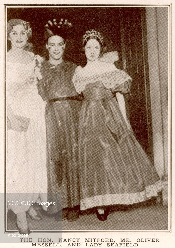 A photograph of a Nancy Mitford, Oliver Messell and Lady Seafield at Mrs A. G. Glasgow's fancy dress ball.