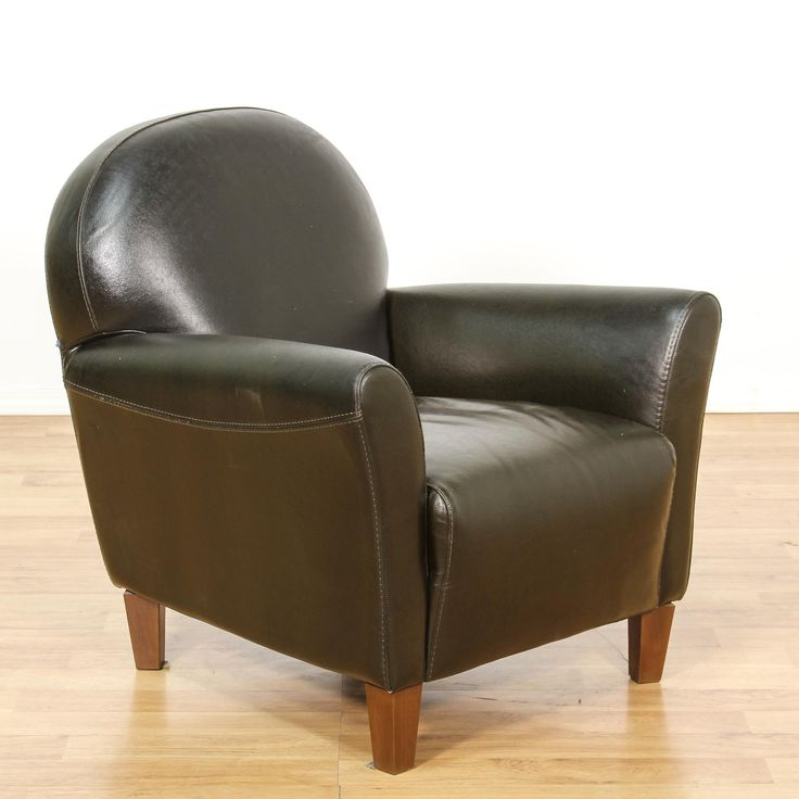 """This """"Calia Italia"""" armchair is upholstered in a durable leather with a shiny black finish. This contemporary accent chair has a curved back, slanted arms and tapered solid wood feet. Sleek and modern chair perfect for lounging!  #contemporary #chairs #armchair #sandiegovintage #vintagefurniture"""