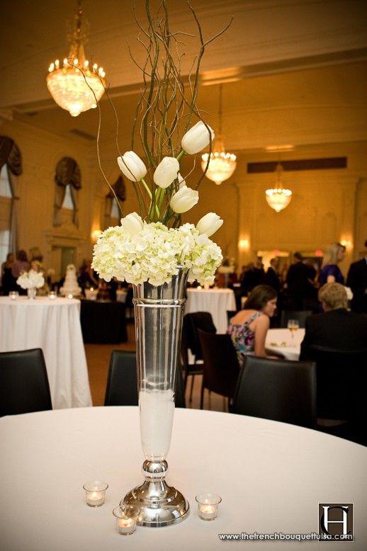 Tall silver reception centerpiece with white hydrangea