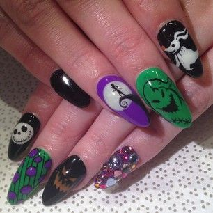 This ode to The Nightmare Before Christmas.   27 Delightfully Spooky Ideas For Halloween Nail Art