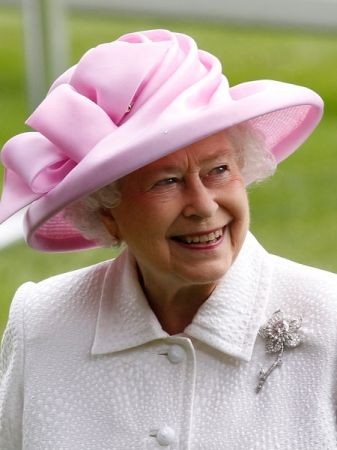 HM Queen Elizabeth II in one of her more becoming hats in a lovely soft shade of pink