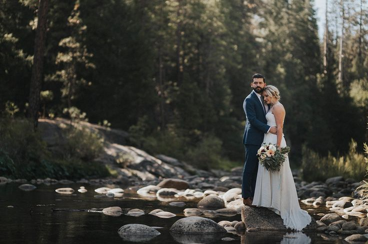 creekside couple portraits from this intimate Yosemite wedding  | Image by Erin & Geoffrey Photography