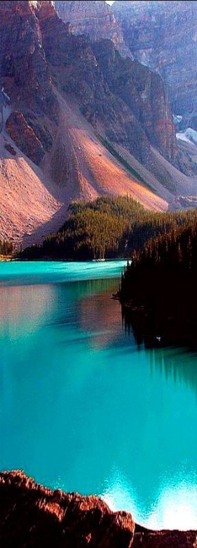 The turquoise waters of Moraine Lake nestled in the Canadian Rockies of Banff National Park, #fluffyhero9
