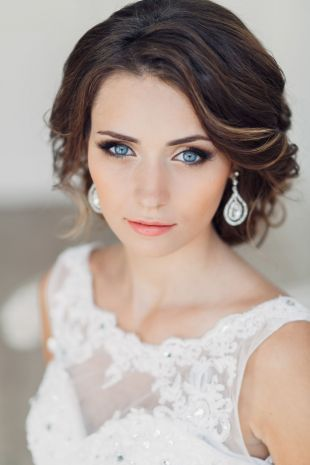 Dark brown hair color on long hair, bridal makeup for blue eyes and dark hair