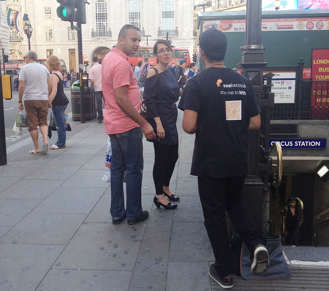 Shah at Piccadilly station chatting to this couple about the travel competition by seekerit, via Flickr