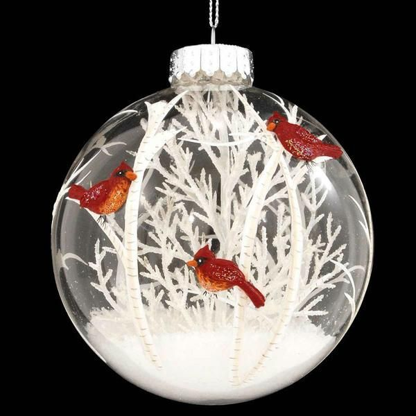 "The center of our clear glass ornament contains a bare white ""tree"" and a flurry of glittering snowflakes that dance throughout the globe when gently shaken."