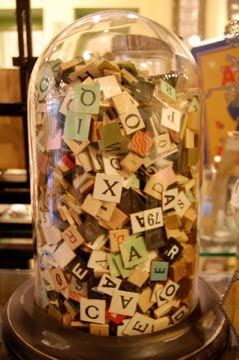 bell jar full of scrabble tiles and game pieces