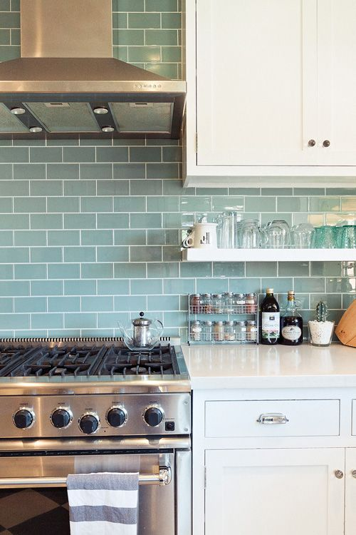 "Sneak Peek: Chelsea and Forrest Kline. ""We love the way the light works with the glass tile and the open shelves open things up and let us see more tile. The oven has delivered us many a pizza party, and for that we thank it."" #sneakpeek"