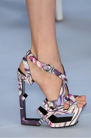 From Paris Celine Spring/Summer 2009 Collection this shoe made the biggest impression on me. Why? Because of the missing insole! Crazy purple/pink colors is an extra plus, but if you don't like it you can have them in white or black. The only question I have is, are they really walkable?Photo: Celine Spring/Summer 2009 runway.