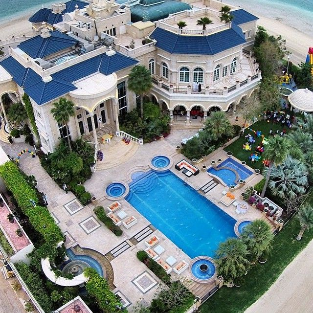 a nice aerial view over a luxurious mansion what do you think