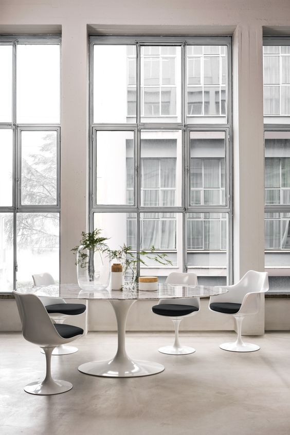 """urbnite: """" Tulip Table Collection by Eero Saarinen Saarinen Tulip Armchair Saarinen Tulip Armless Chair """""""