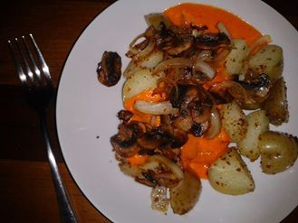 Minimalist Baker Blogs Roasted Red Pepper Sauce but instead of pasta I did potatoes covered in Victorian Epicure HOT BLT vegan spice mix and olive oil topped with sauteed mushrooms and onions.