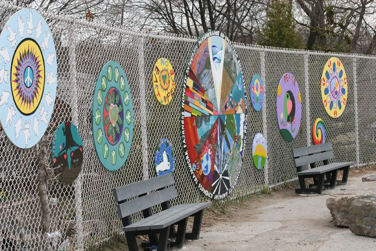 Peace Circle Garden  Created as a way to provide a quiet play space in a busy school yard, this Peace Garden used rock seating, tree planting and large mandala paintings to establish a dedicated space for peace education for students and teachers at this school. © Hilary J. Inwood, 2010