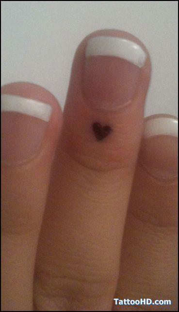 artistic small tattoos | small tattoos ideas , Small Tattoos Looks like an angel kiss but heart shaped!!.