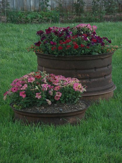 Old rusty tractor wheels for planters -