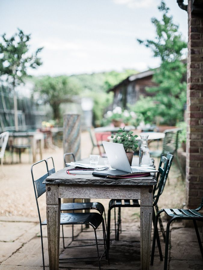 Petersham Nurseries - a taste of the countryside in London | working in the garden with apple mac laptop // Photo by @chikaeoh