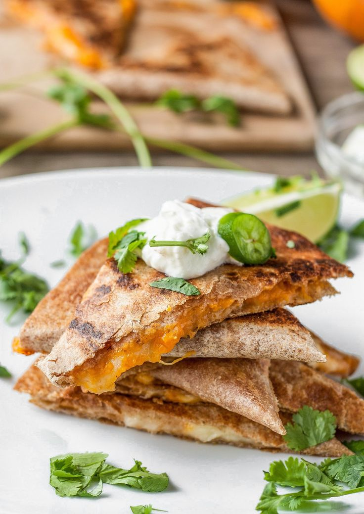 We harvested so many sugar pumpkins at our farm this season that we had plenty left even after filling all of our CSA boxes, selling at farmers markets, and delivering to restaurants. I don't mind one bit! I've spent my recent evenings roasting and pureeing as many pumpkins as I can. Once I got tired of pumpkin soup, these cheesy pumpkin quesadillas made a nice change of pace for using up the puree!
