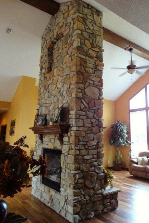 Unique and pretty use of stone and a see through fireplace