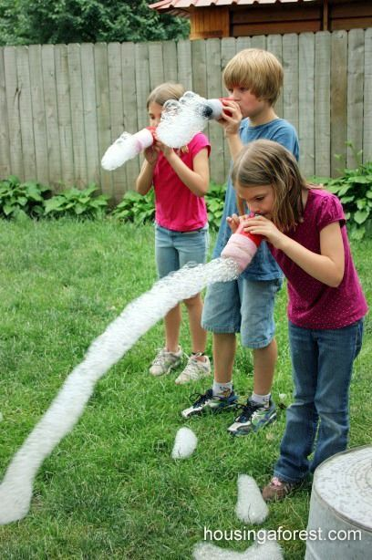 These bubble blowers are made from plastic bottles, an old sock and a rubber band.  Who said kids these days have no imagination?