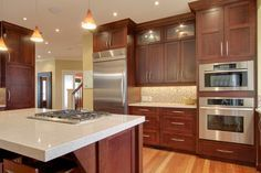 Great countertop choice; high end appliances; custom touches (glass cabs up top); most of all EXCELLENT layered lighting: pendants, pot lights, in-cab lighting & undercabinet lighting; Cherry Kitchen traditional kitchen cabinets