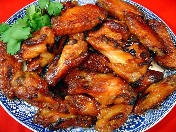 Baked chicken wing appetizers with a fruity pineapple-orange based sauce. Very good! Great for parties and sports get-togethers.