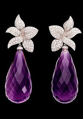 A pair of amethyst, tot. app. 9 cts, and brilliant cut diamond earrings, tot. 1.18 ct. 18k white gold.