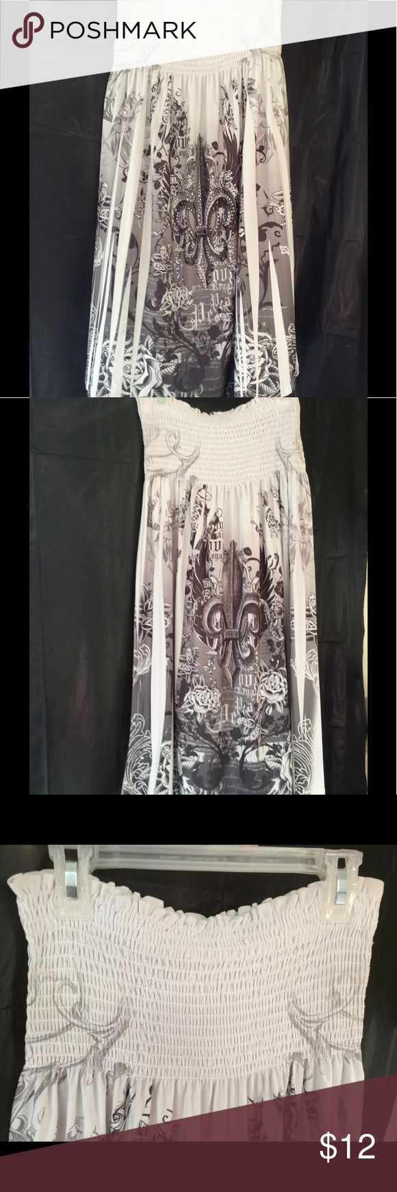 White Tube Top Dress sz M Excellent used condition, white dress with black fleur de lis design covering the sides and lower portion of the dress. There are also clear and black colored embellishments on the front of the skirt to detail the design. The bodice is smocked for comfortable fit. There are no snags, stains, rips or missing beading on the dress. Dresses Midi